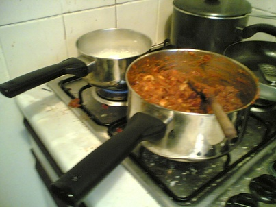 A pan of chilli and a pan of rice