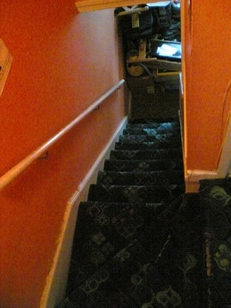 Tidy stairwell up to The Flat