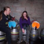 Dan & Claire drink beer in a lambing shed