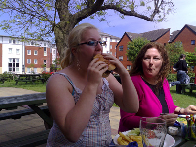 Becky stuffing a huge burger down her face hole