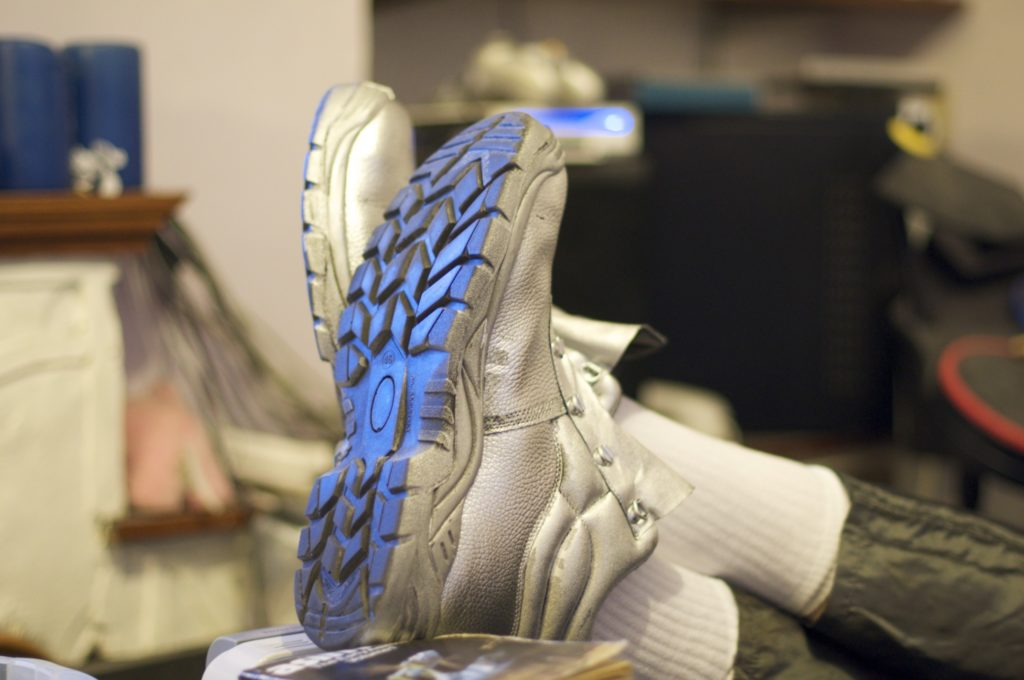 Adam's trainers, spray-painted silver.
