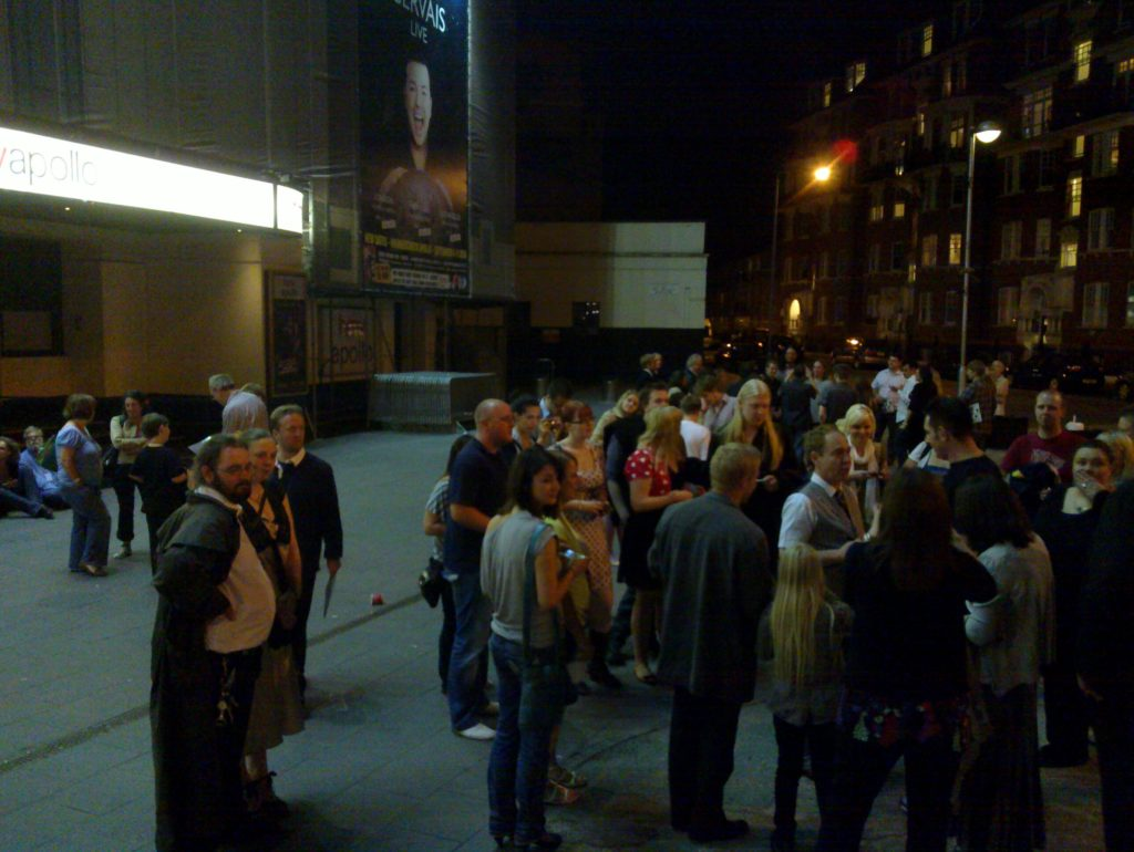 A crowd outside the theatre.