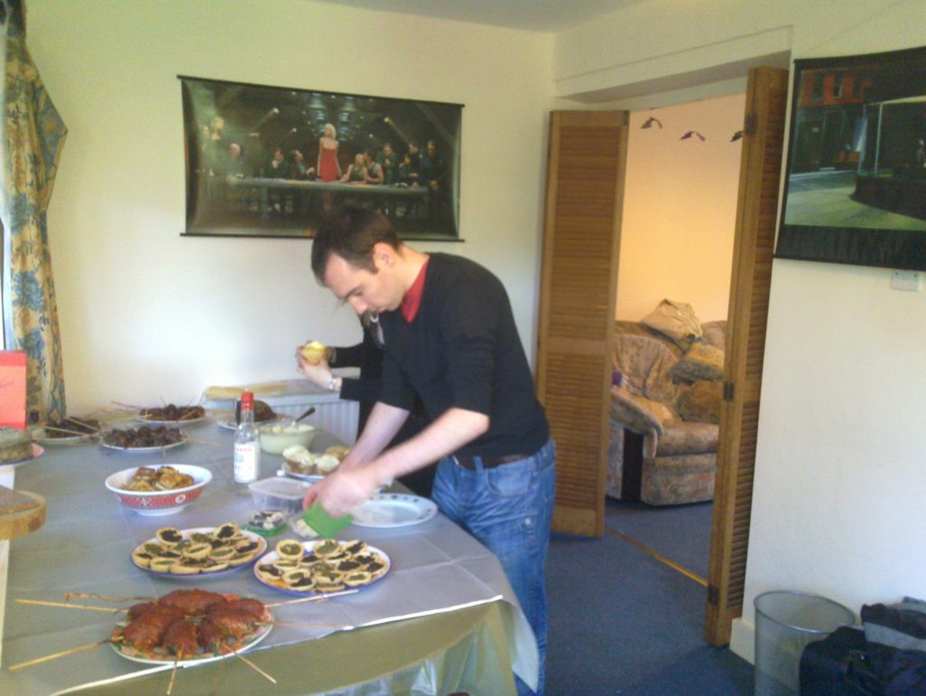 Simon laying out food.