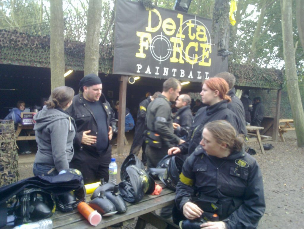 Party people planning paintball play preparations.