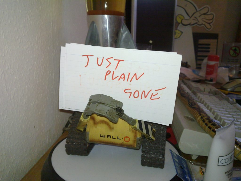 "WALL-E holding a ""just plain gone"" sign."