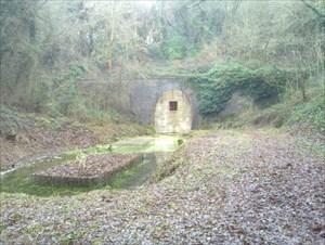 Bricked-up railway tunnel near a geocache.