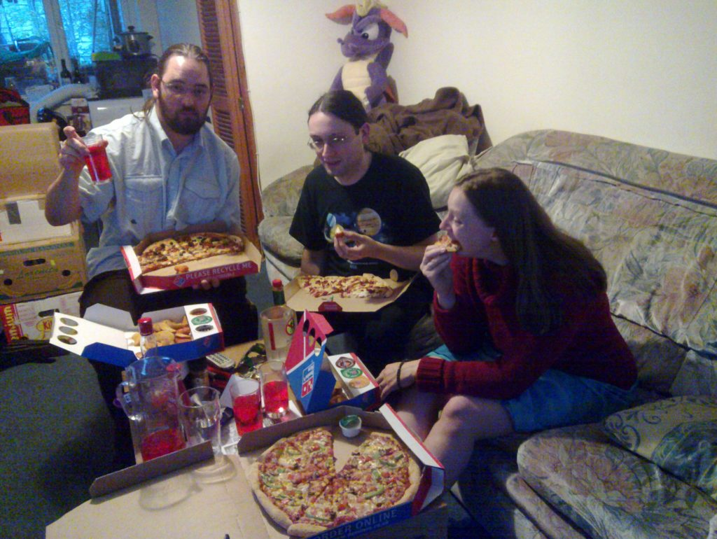 JTA, Paul and Ruth eat pizza and drink Earth Sunset.