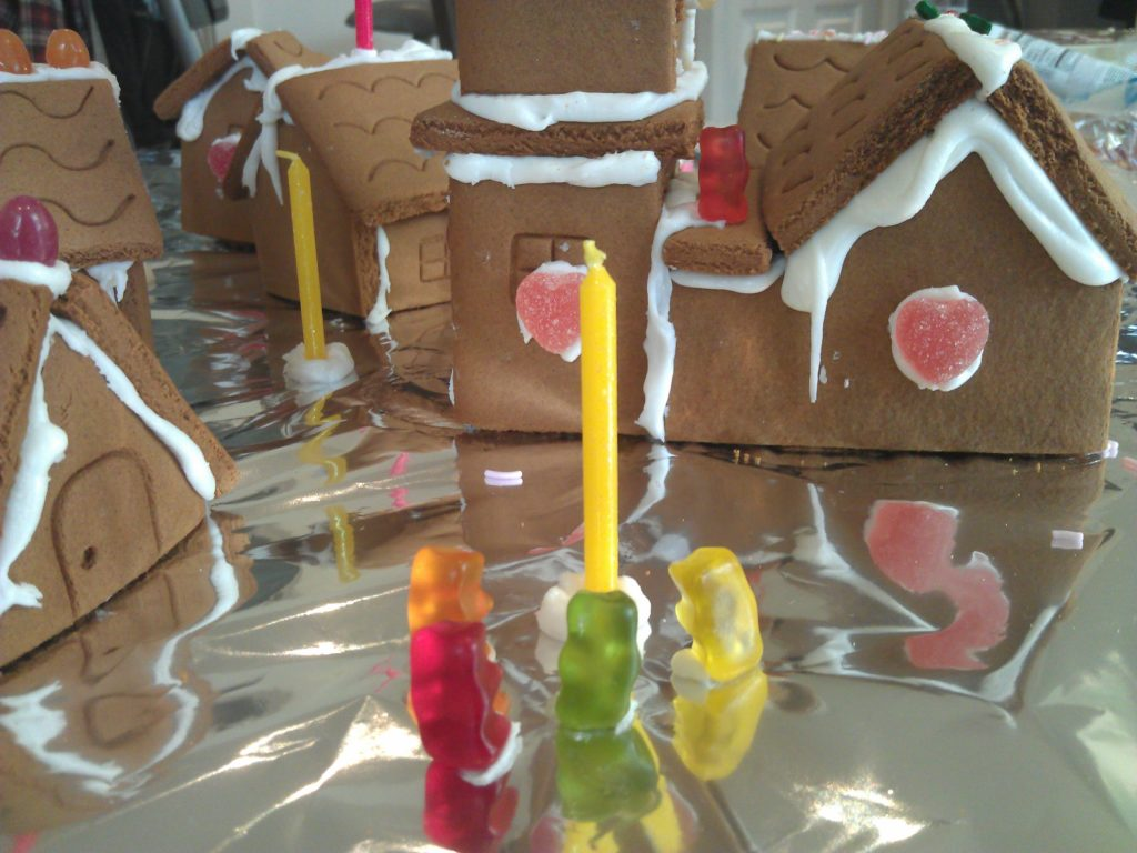 Gummy-bear citizens gather around a candle lamp-post in the gingerbread village. Little do they know of the horror that approaches...
