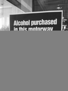 "Sign: ""Alcohol purchases in this motorway service area can not be consumed inside or outside the premises."""