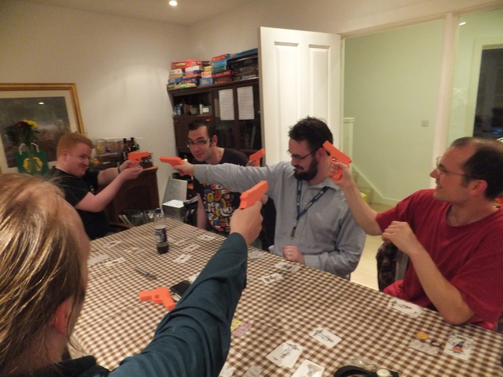 Some early guests play Ca$h 'N' Gun$, a live-action game of gun-toting gangsters.