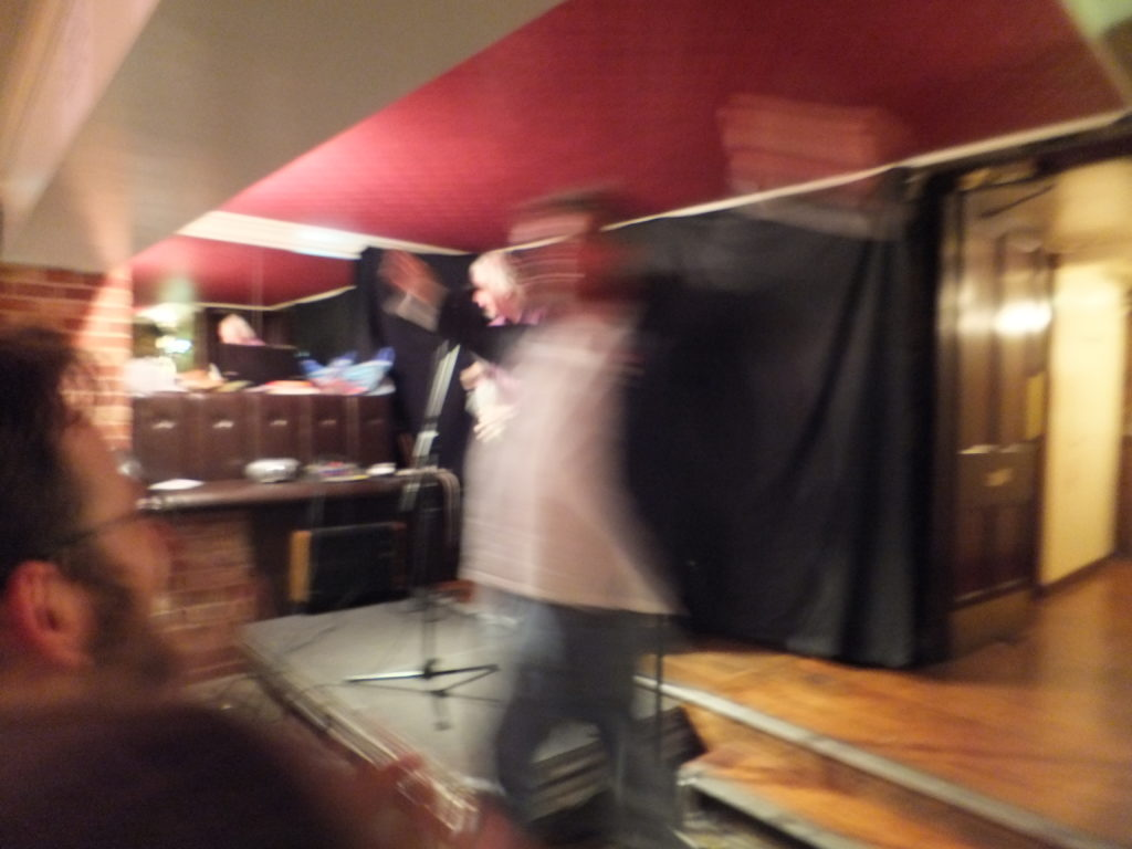 Phill Jupitus leaps around in front of JTA.