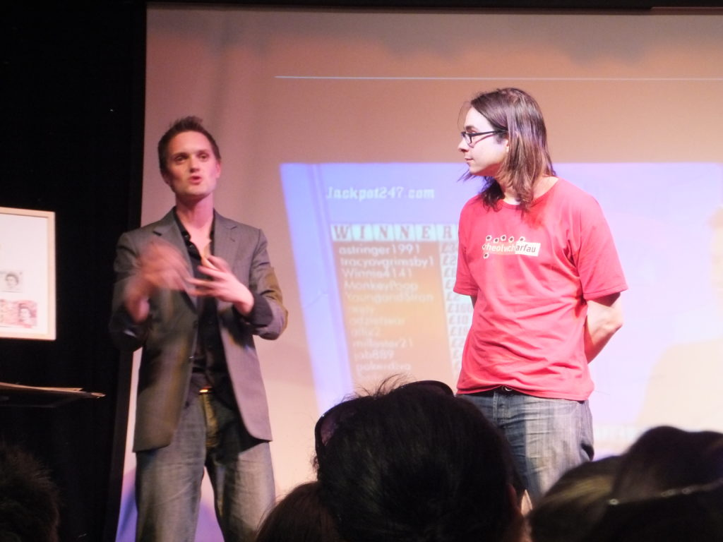 Matt R joins Sam Strange on stage to assist him with a magic trick.