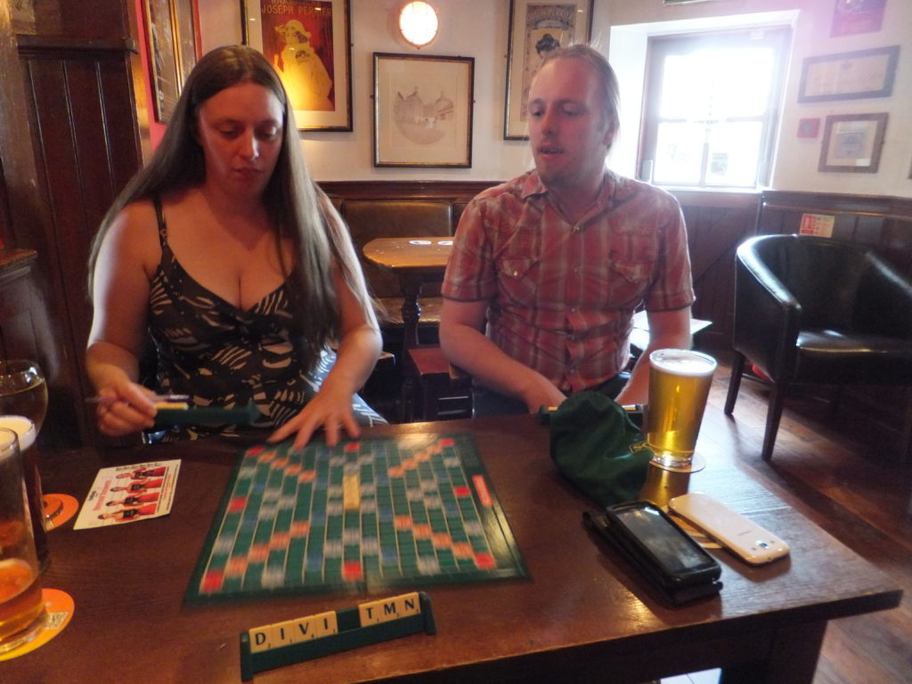Ruth and Dan playing Scrabble[TM] in a pub in Leith.