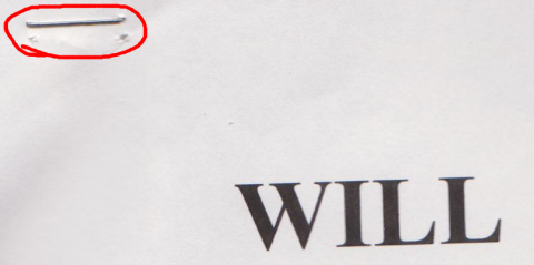 A close-up of my dad's Will, showing where it was clearly re-stapled.