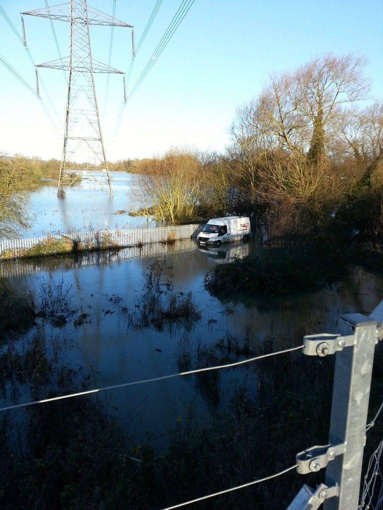 Network Rail engineers sinking into a flooded field