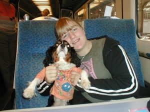 My sister Becky with Puddles, on a train.