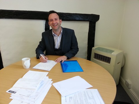 Mortgage broker Stefan Cork amidst our mountains of paperwork.