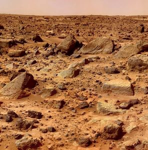 Photograph of Mars as taken by a rover.