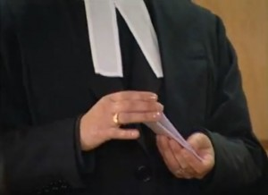 A court clerk shufles a deck of 15 slips of paper.