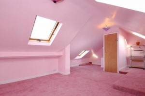A very pink attic bedroom.