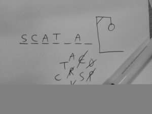 A game of hangman; SCAT_A_, wrong guesses are R, E, O, P, L, H.