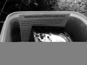 Harmless Electronic Game Piece, written above Box One, in situ
