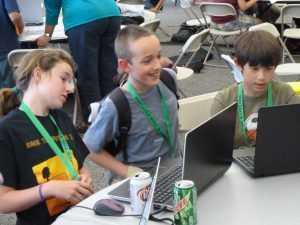 Children programming on laptops. Photograph copyright Steven Luscher, used under Creative Commons license.