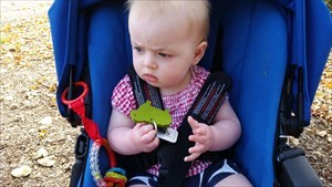Baby Annabel with a geocache.