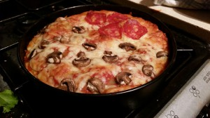 Pizza cake freshly removed from the oven.