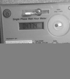 Electricity meter with red light showing.