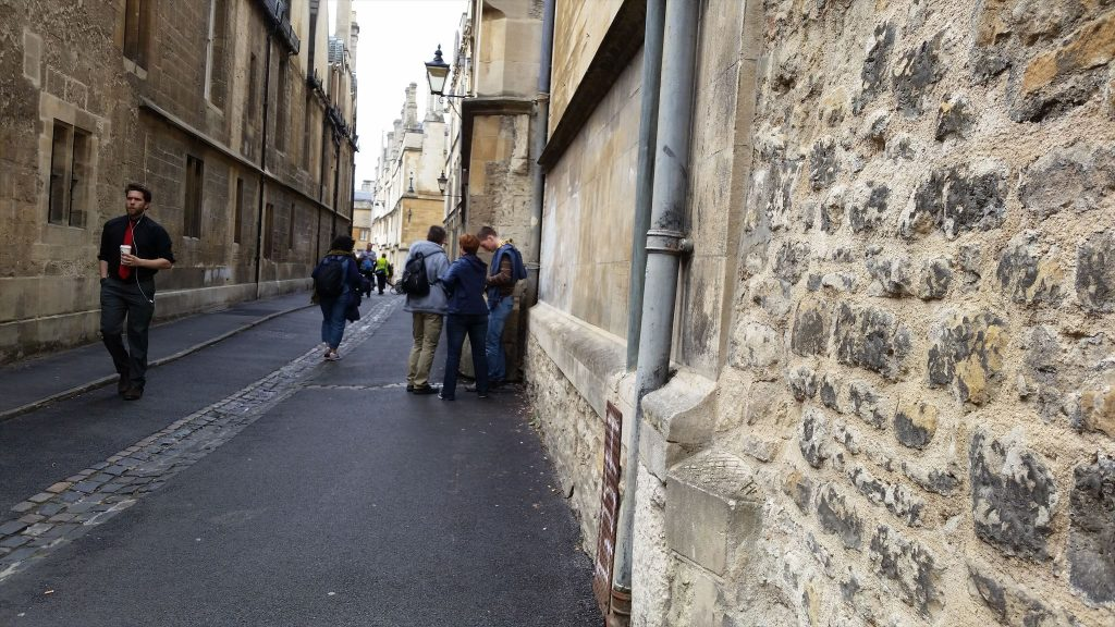 Suspected-geocachers in Brasenose Lane.
