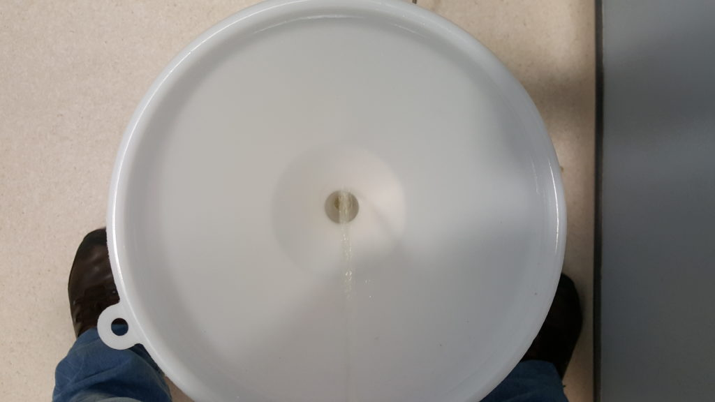 A stream of urine pours down into a funnel.