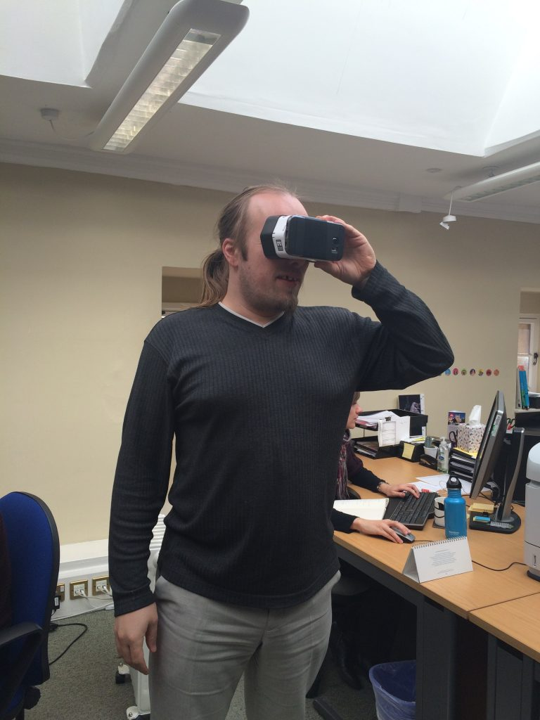 Dan stomps around his office wearing a Google Cardboard.