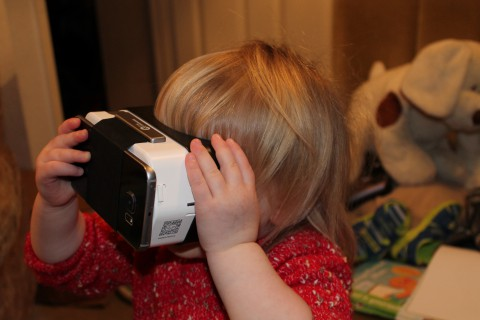 Annabel plays with a Google Cardboard with a Samsung Galaxy S6 Edge attached.