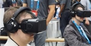 Two gamers wearing Oculus Rift headsets.