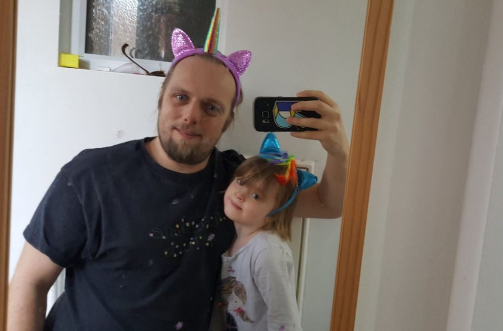 """Dan and Annabel wearing My Little Pony headbands. Dan is also wearing a T-shirt that reads """"Masculine as fuck"""", written in flowers, although he hadn't thought about that at the time."""