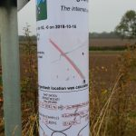 Geohashing sign attached to a convenient sign post.