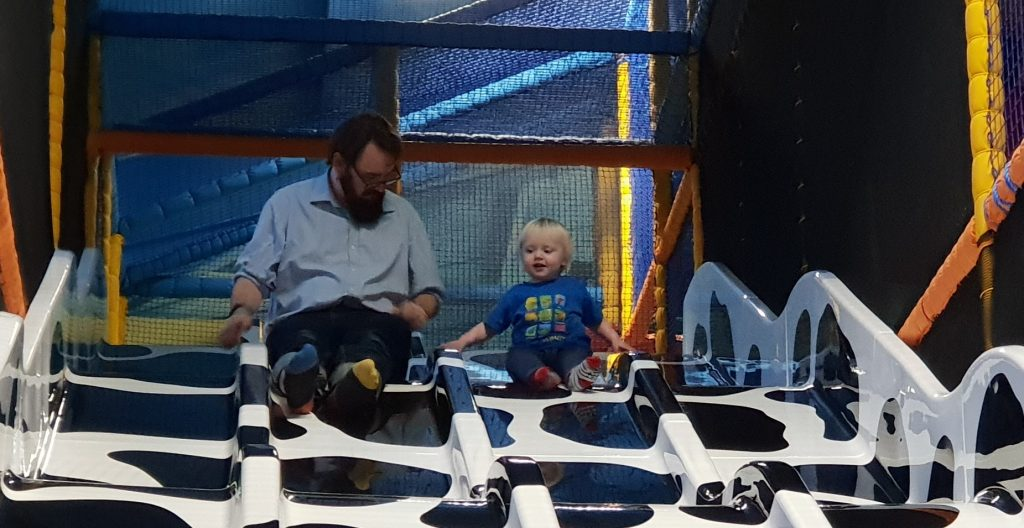 JTA with his youngest, on a slide.