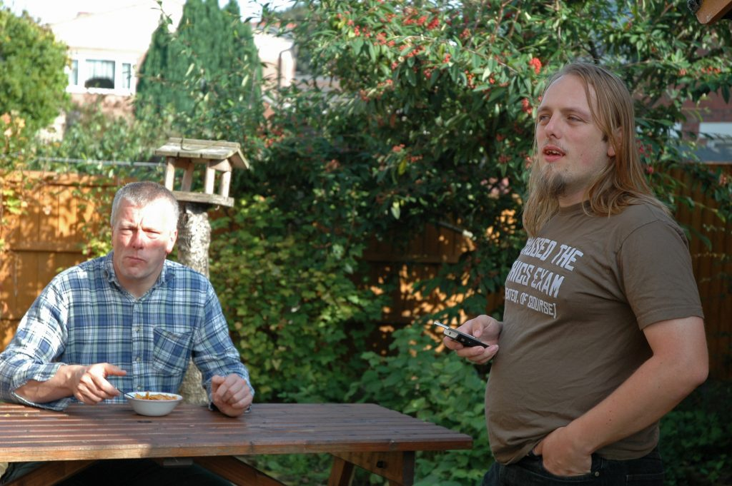 Dan and his dad have breakfast in the garden.