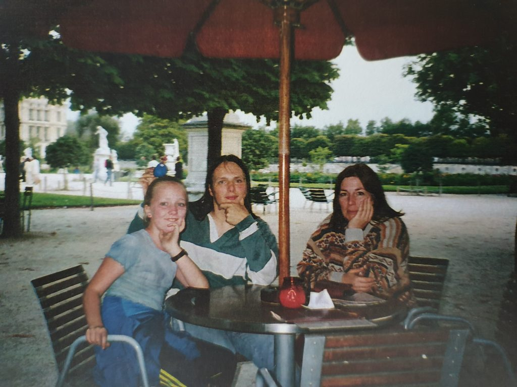 Dan with his sister and his mother in a Paris cafe, in advance of the August 1999 solar eclipse.