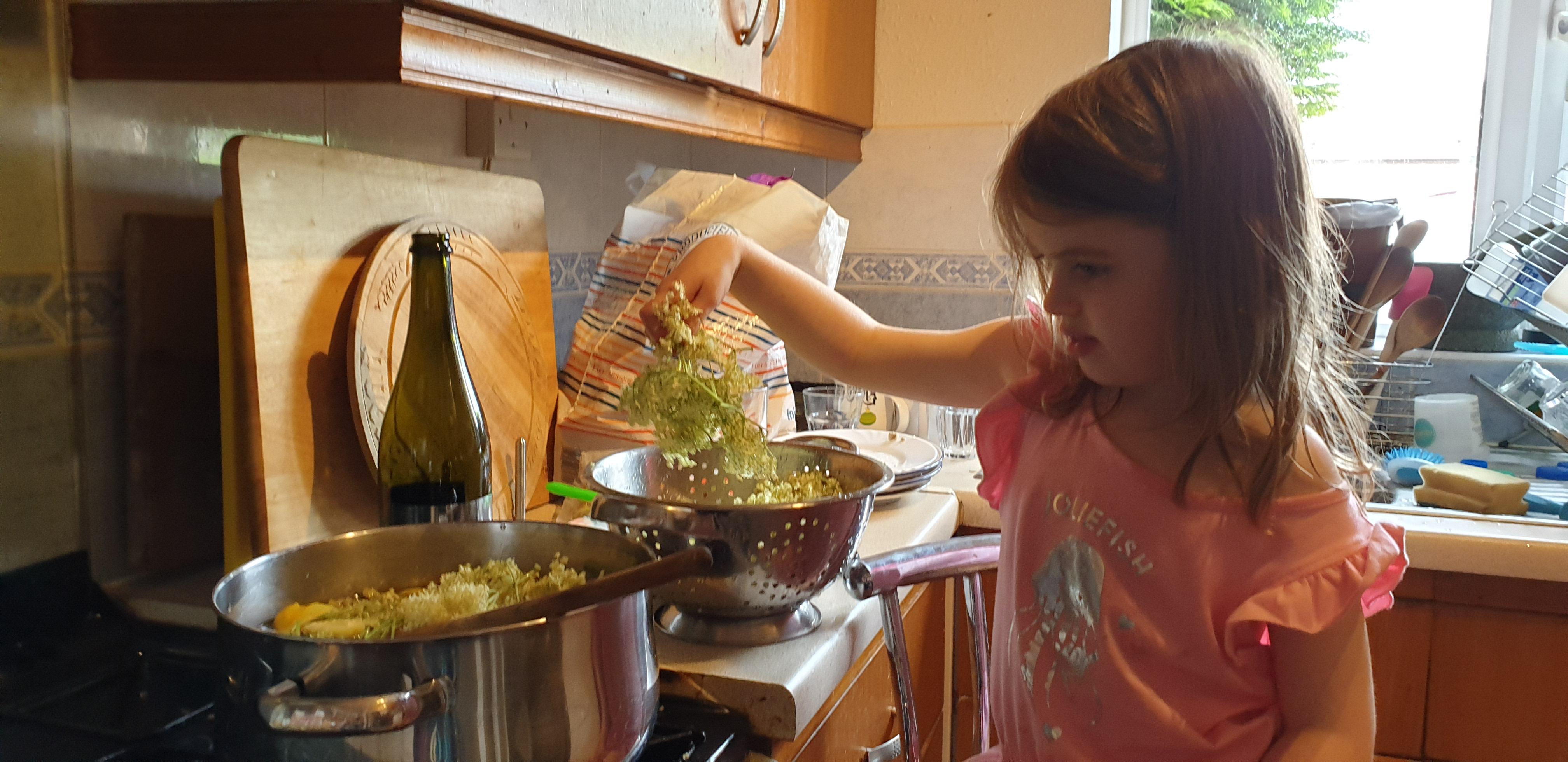 Annabel making elderflower cordial