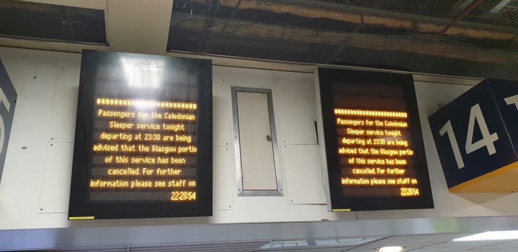 "Digital display board: ""Passengers for the Caledonian Sleeper service tonight departing at 23:30 are being advised that the Glasgow portio [sic] of this service has been cancelled. For further information please see staff on"""