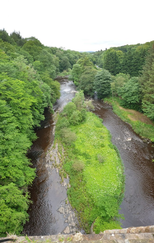 River Almond viewed from the Union Canal aqueduct that spans it (edited: removed aeroplane)