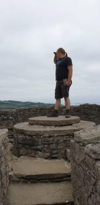 Dan atop a plinth in Craigmillar Castle