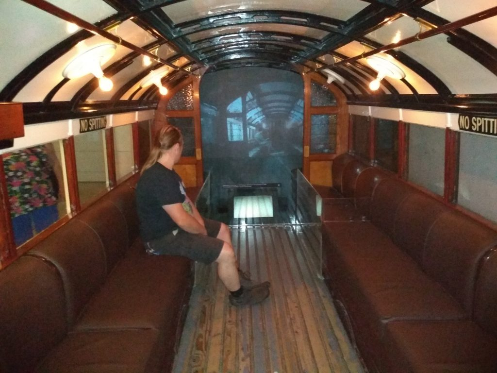 Dan sits aboard a replica of an original Glasgow subway train.