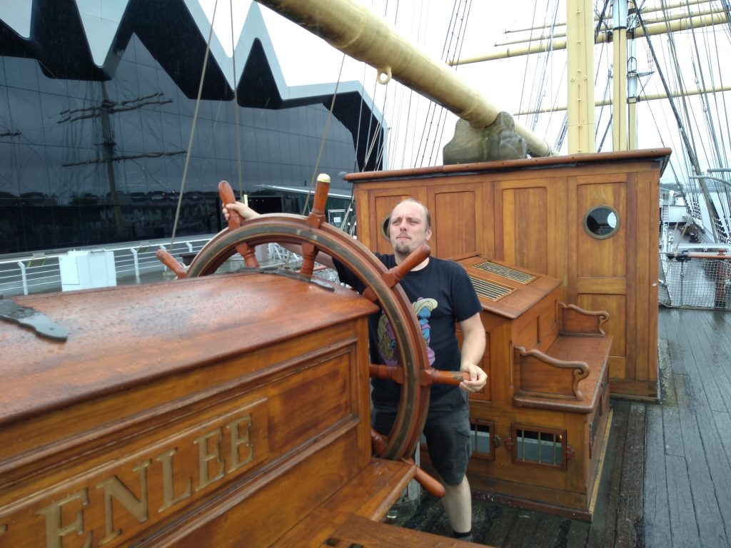 Dan at the wheel of the Glenlee