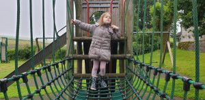 Annabel on the climbing frame.