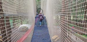 Annabel climbs up to the top nets.