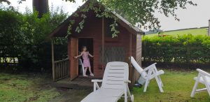 Annabel at the door of her playhouse.