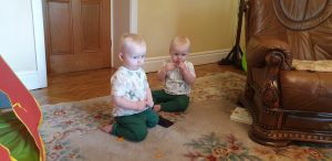 The twins on the living room floor.